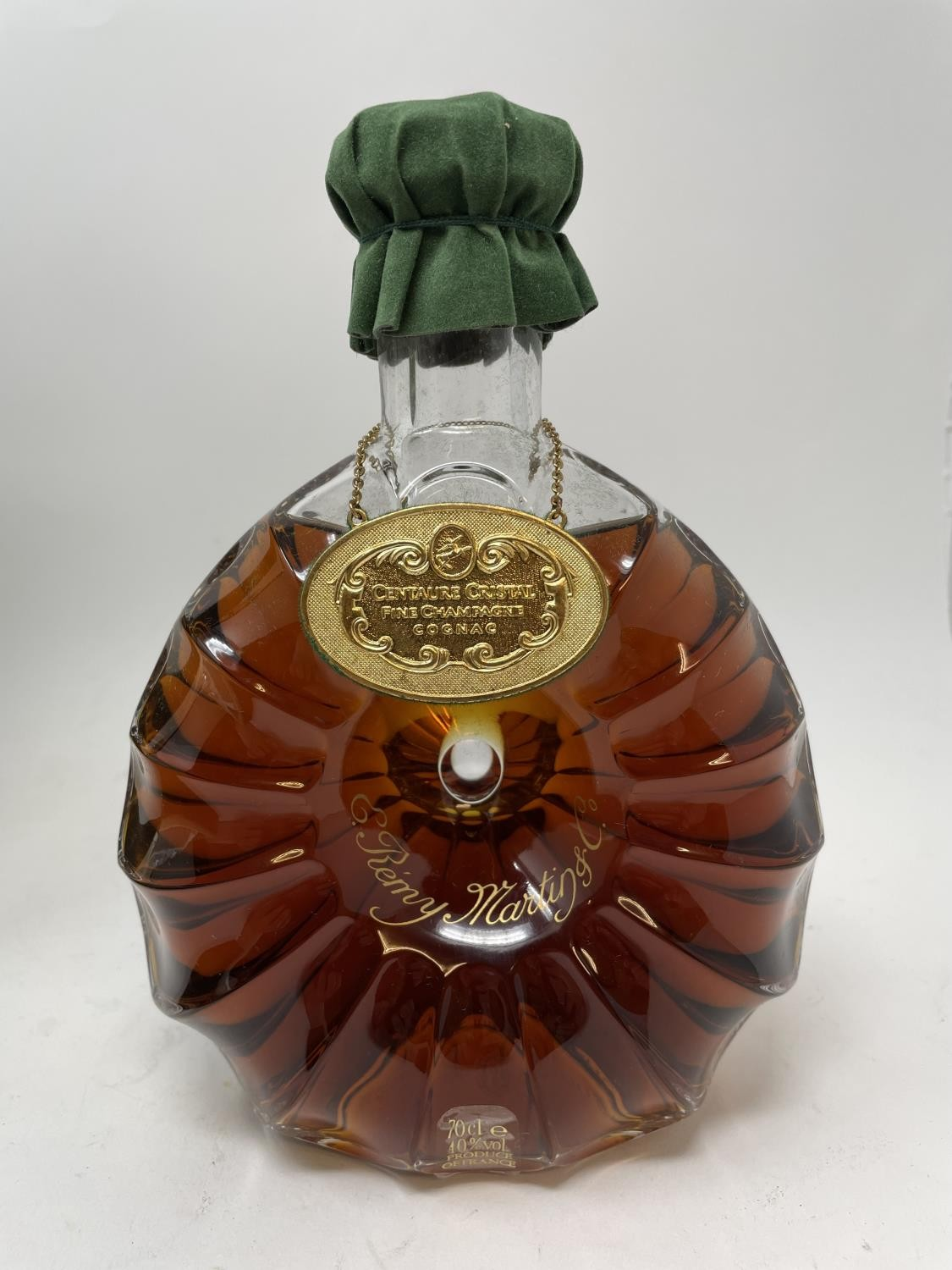 A 70 cl bottle of Remy Martin Cognac, in a Baccarat decanter bottled 27 October 1986, with