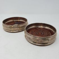 A pair of silver and mahogany bottle coasters, London 2000 (2)