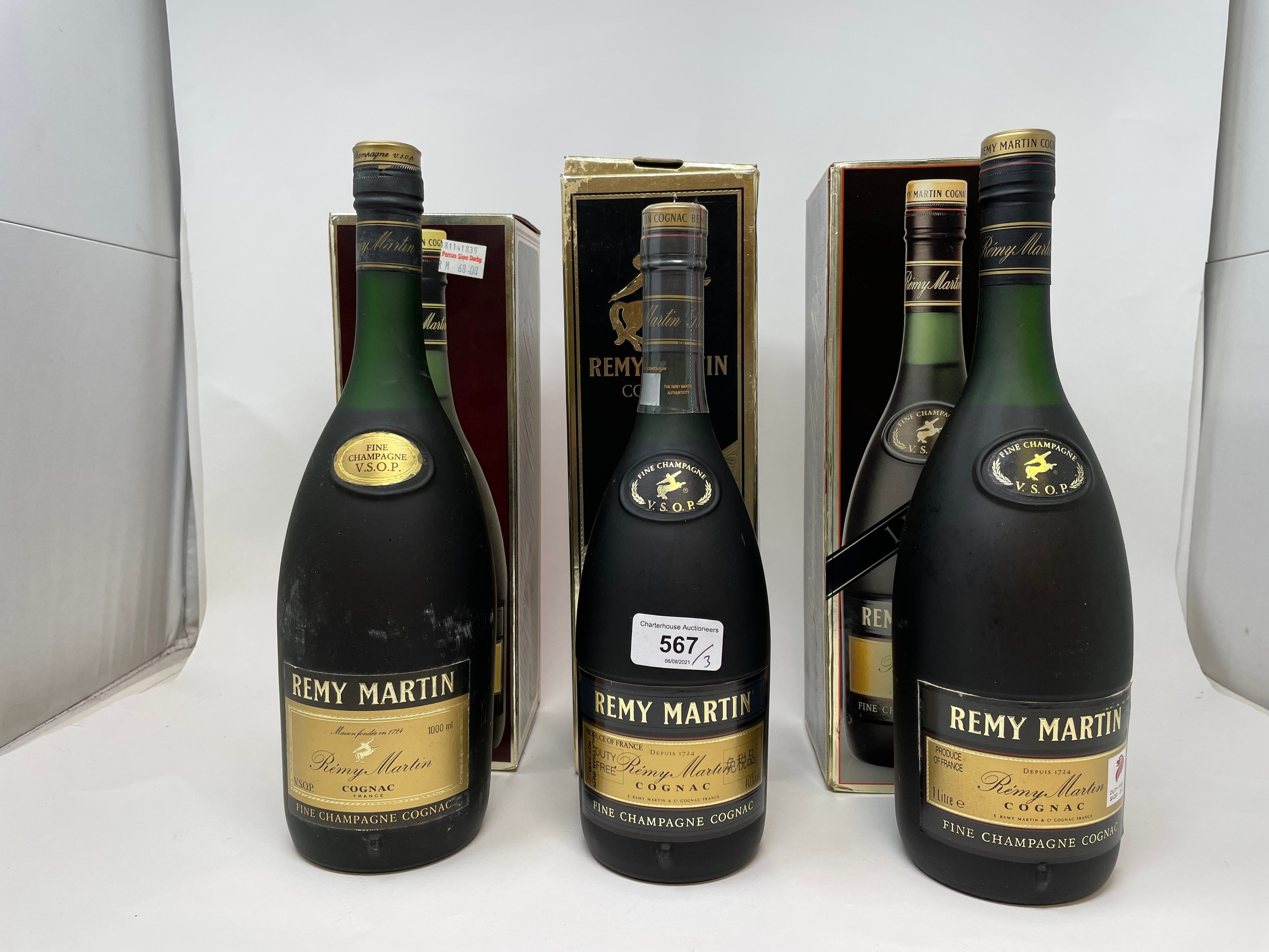 Two litre bottles of Remy Martin cognac, and another, all with boxes (3)