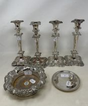 A set of four silver plated candlesticks, a bottle coaster and a card tray (6)