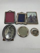 An Edward VII silver photograph frame, Birmingham 1900, and five other silver photograph frames,