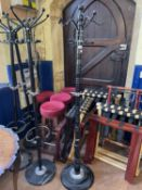 Four coat stands, four bar stools, and various luggage stands (qty)