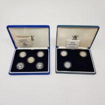 Eight £1 silver proof coins, 1983-1987, and 1994-1996, with three certificates in two boxes (2)