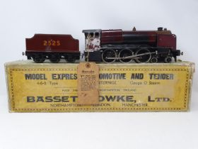 A Bassett-Lowke O gauge 4-6-0 locomotive and tender, 2525, boxed Front end plate detached, has