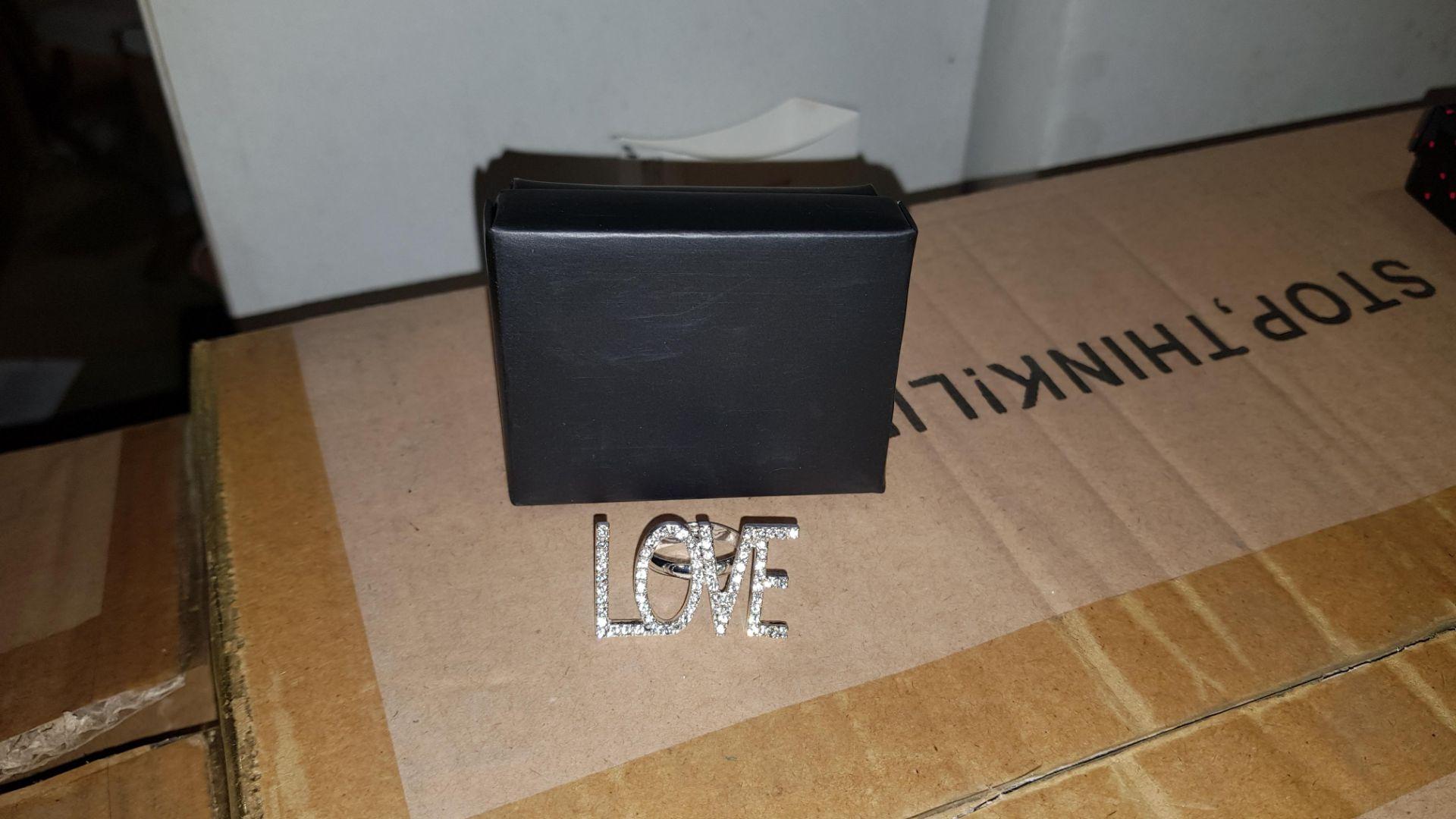 224 X AVON DAMARA MARK STATEMENT RING - LOVE