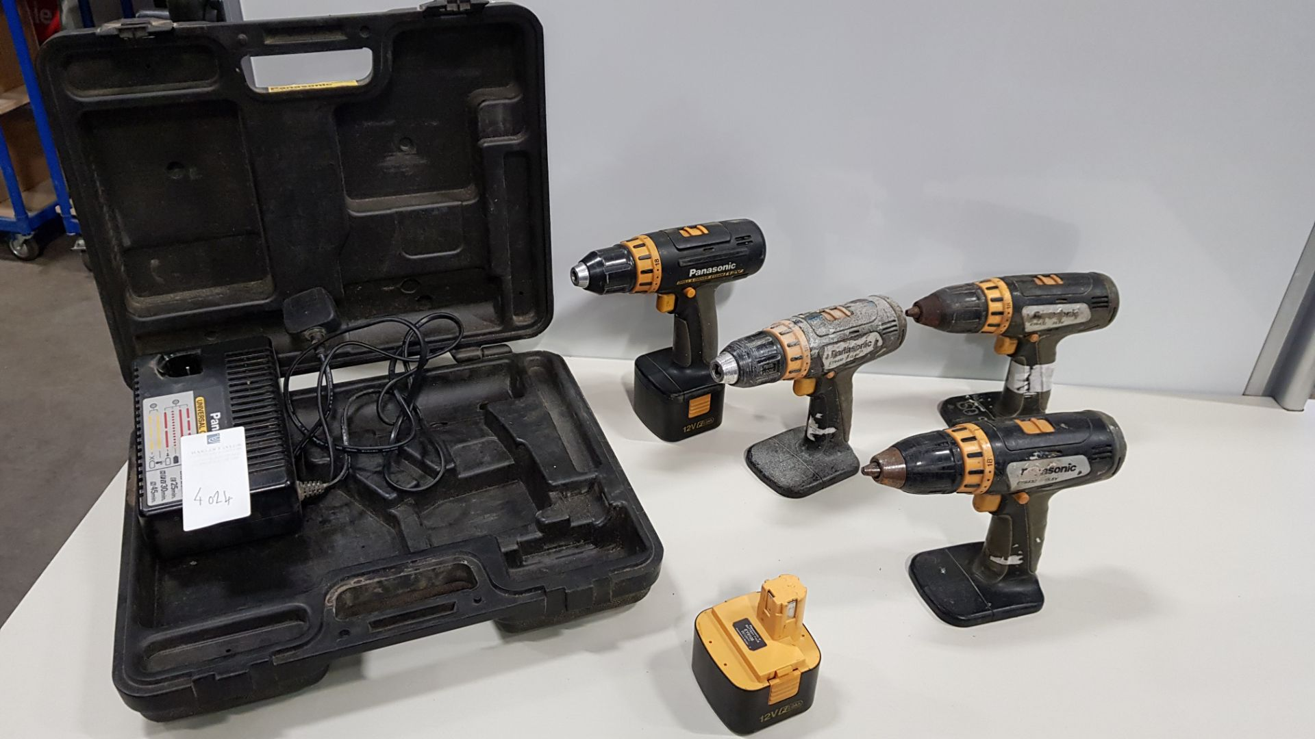4 X PANASONIC DRILL SHELLS 2 X BATTERYS, CHARGER AND CARRY CASE