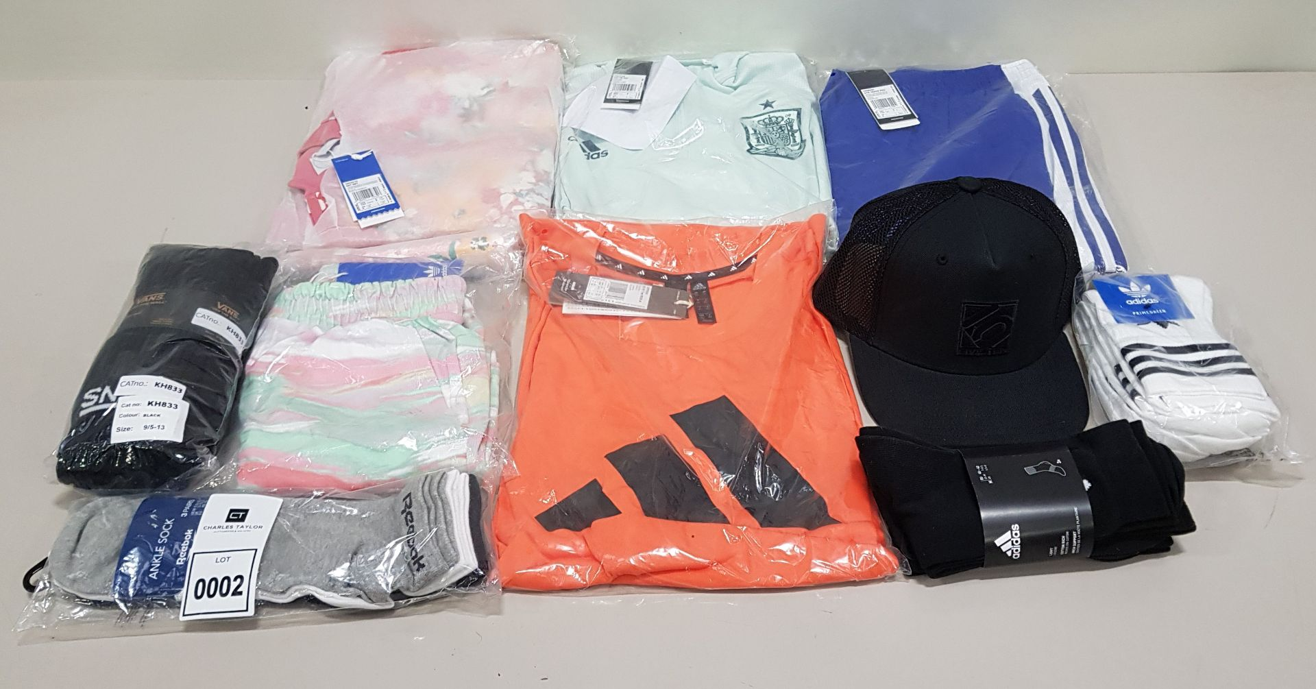 10 PIECE CLOTHING LOT CONTAINING ADIDAS SOCKS, VANS SOCKS, ADIDAS HAT, ADIDAS TRACK PANTS AND REEBOK