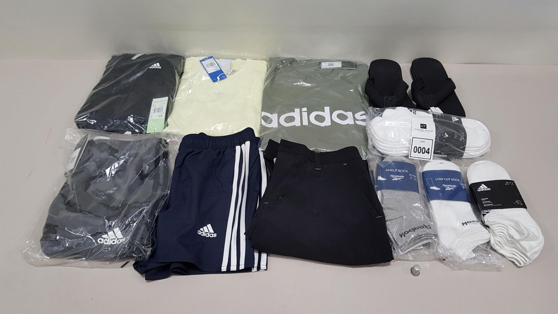 11 PIECE CLOTHING LOT CONTAINING REEBOK & ADIDAS SOCKS, ADIDAS SHORTS, ADIDAS PANTS AND AN ADIDAS