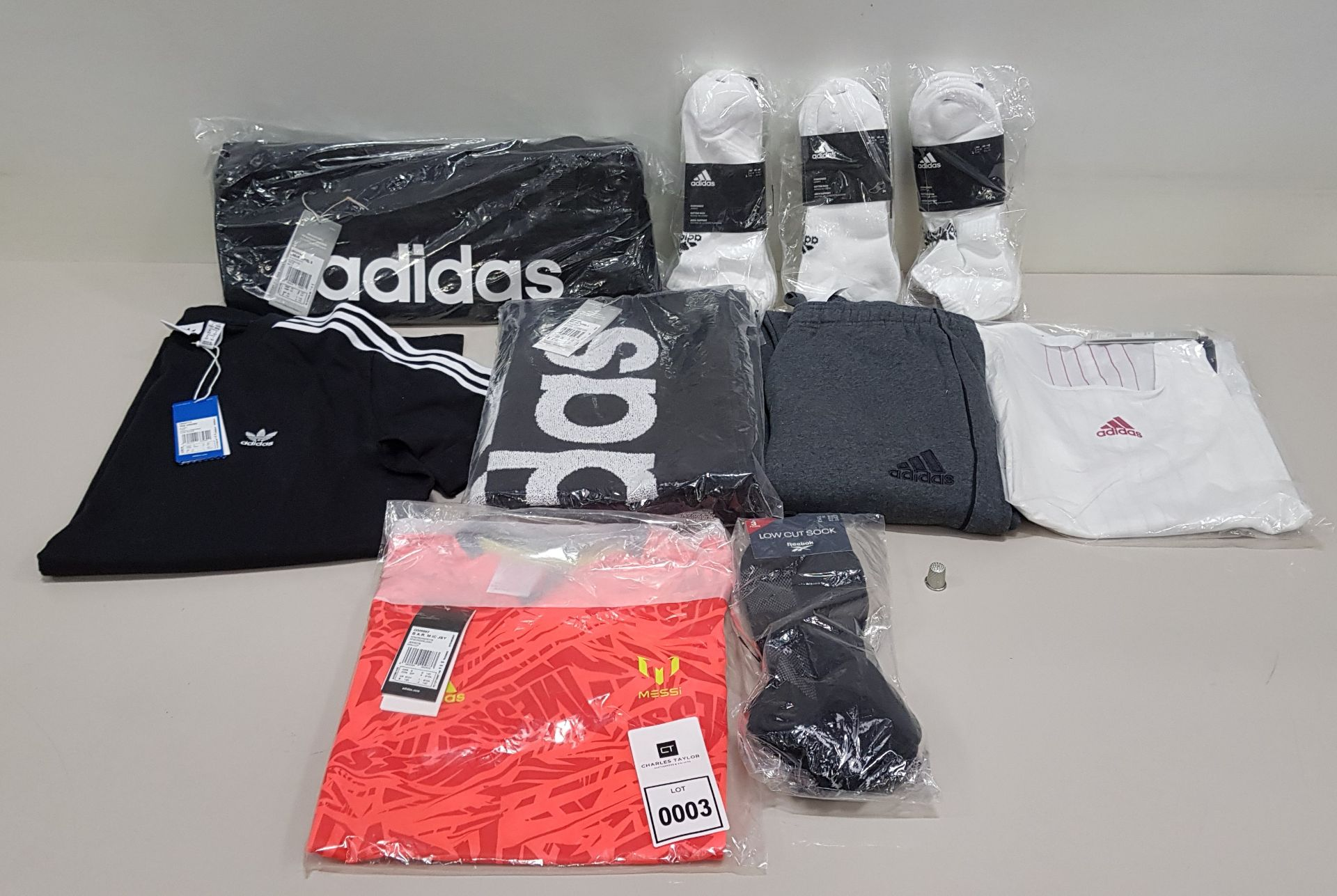 10 PIECE CLOTHING LOT CONTAINING ADIDAS SOCKS, ADIDAS T SHIRT, ADIDAS SWEATPANTS AND AN ADIDAS