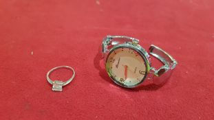 2 PIECE ASSORTED LOT CONTAINING 1 X WATCH BRANDED RAMELIA AND 1 X SILVER COLOURED RING WITH CLEAR