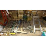 LARGE QUANTITY ASSORTED LOT CONTAINING LADDERS, GARDEN HOSE AND VARIOUS GARDEN TOOLS.