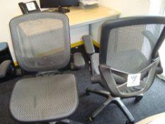 Three elbow swivel chairs