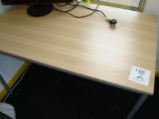 A quantity of light oak effect office furniture including four tables and a double door full