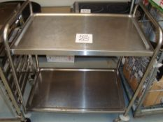 A stainless steel mobile trolley