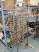A mobile full height stainless steel tray rack