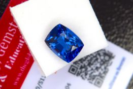 BLUE STONE WITH CARD MARKED SAPPHIRE