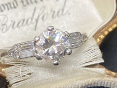 VINTAGE PLATINUM DIAMOND SOLITAIRE WITH DIAMOND BAGUETTE SHOULDERS 1.40ct TOTAL DIAMOND WEIGHT