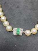 VINTAGE CULTURED PEARL NECKLACE - WHITE METAL CLASP SET WITH EMERALDS & DIAMONDS (TESTED WHITE GOLD)