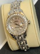 WHITE GOLD & DIAMOND WATCH FITTED WITH ROLEX MOVEMENT