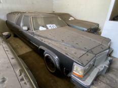 APPROX 1983 CADILLAC FLEETWORD FLOWER CAR HEARSE IN BLACK WITH KEYS