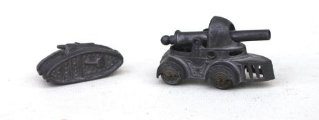 A grey metal matchstick firing WW1 Tank on 4 wheels 54mm (2.125ins) long together with another