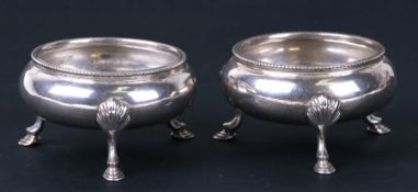 A pair of Victorian silver open salts standing on three legs, London 1856. 7cm ( 2.75 ins) diameter.