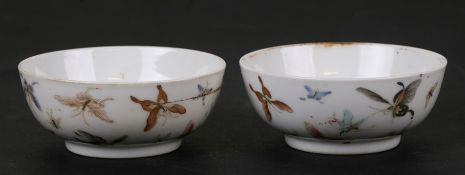 A pair of Chinese porcelain wine cups decorated with butterflies, four character red mark to the