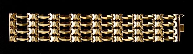 An 18ct gold articulated cuff bracelet, weight 47g. 19.5cm long 3cm wideCondition Reportgood overall