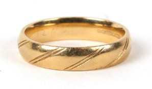 An 18ct gold wedding band. Approx. UK size V. 8gCondition ReportGood general condition and hallmarks