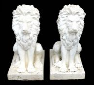 A large pair of weathered fibreglass rampant lions, each approx. 89cms (35ins) high (2).