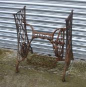 A cast iron Singer sewing machine treadle table base, 60cms (23.75ins) wide.