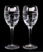 A pair of Waterford Crystal 'Rain' cut glass wine glasses, designed by Terence Conran, 23cms (