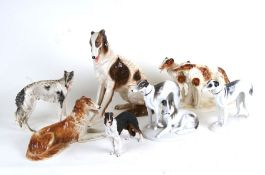 A quantity of porcelain Borzoi figures and similar items, the largest 33cms (13ins) high.Condition