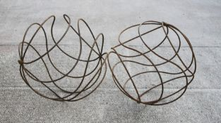 A large pair of steel openwork garden spheres, 66cms (26ins) diameter.Condition ReportGood overall