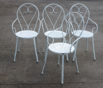A set of four painted wire work scroll garden chairs (4).