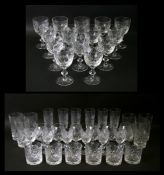 An extensive suite of Edinburgh Crystal Iona pattern cut glass glasses to include wine glasses,