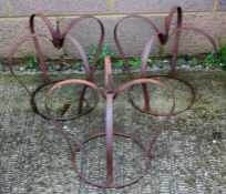 Three wrought iron strap work crown garden planters, each 41cms (16 ins) high.