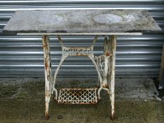 A cast iron garden table with slate rectangular top, 107cms (42ins) wide.