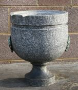 A granite font, 30cms (12ins) diameter.Condition Report There are chips to the upper rim and the