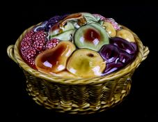 A Sarreguemines majolica tureen and cover in the form of a basket of fruit, 21cms (8.25ins)