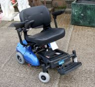 A Care Co. electric wheelchair.