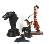 An Art Deco style group depicting a lady walking a Borzoi, 44cms (17.25ins) high; together with a