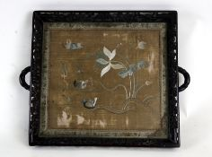 A 19th century Chinese hardwood carved two-handled tray inset with a central silk panel depicting