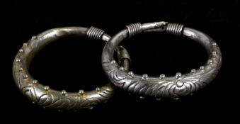 A pair of Asian white metal (not tested) bangles, 8cms (3.1ins) diameter (2).