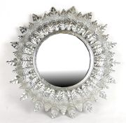 A modern silvered circular wall mirror, 42cms (16.5ins) diameter.