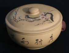 A Chinese Yixing pot and cover decorated with a bird amongst prunus, with calligraphy to the side,