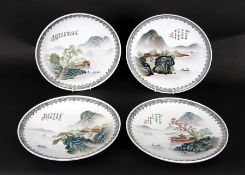 A set of four Chinese Republic style plates decorated with river landscape scenes and calligraphy,