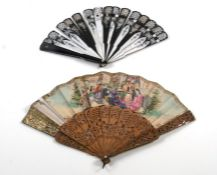A continental pierces wooden fan decorated a bull fighting scene (A/F) ; together with a lacquer fan