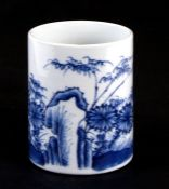 A Chinese blue & white bitong brush pot decorated with flowers and insects, 12cms (4.75ins) high.