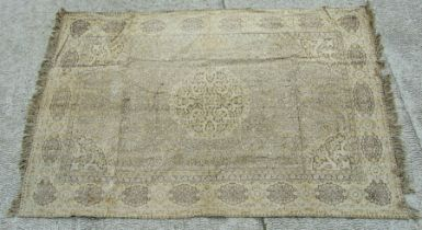 A Persian rug with central medallion on a beige ground, 124 by 188cms (49 by 74ins).